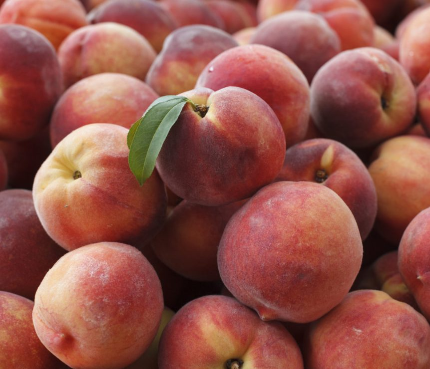 Peaches are displayed for sale with summer fruits and vegetables at a farmers market in Falls Church, Va., Saturday, July 28, 2017. (AP Photo/J. Scott Applewhite)